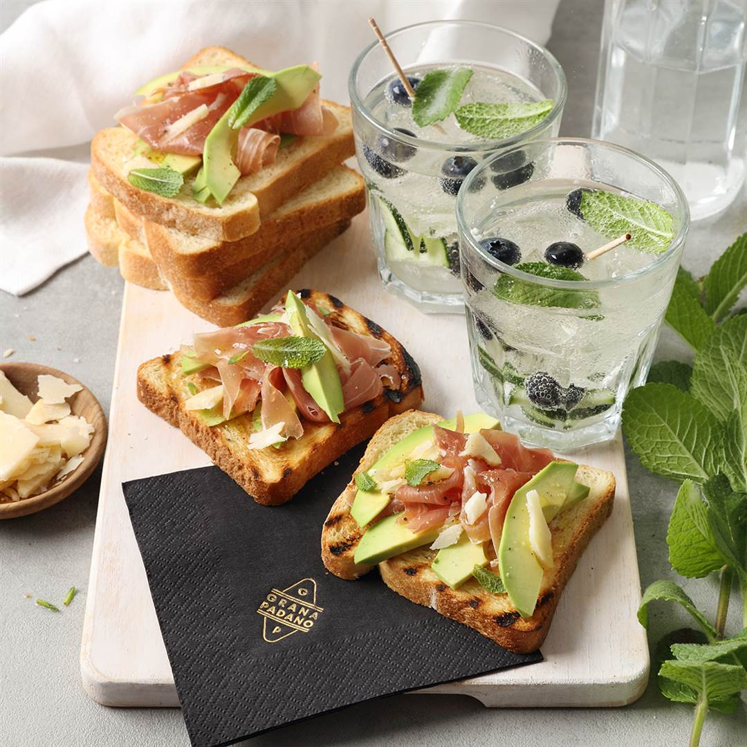 Cucumber, blueberry and lemon flavoured water & bruschetta with avocado, prosciutto and shavings of Grana Padano Riserva