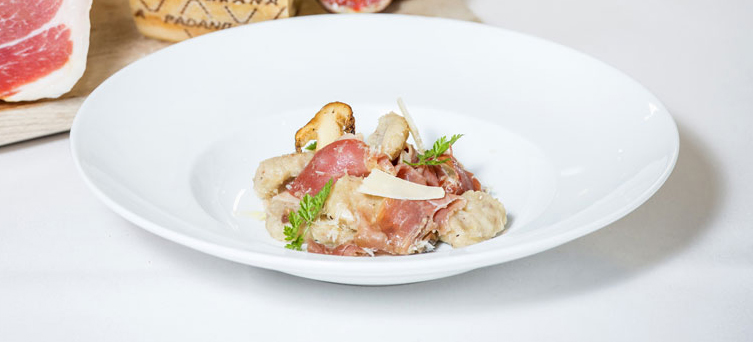 Chestnut Gnocchi with Roasted Porcinos, Prosciutto di San Daniele, Pomegranate and Grana Padano