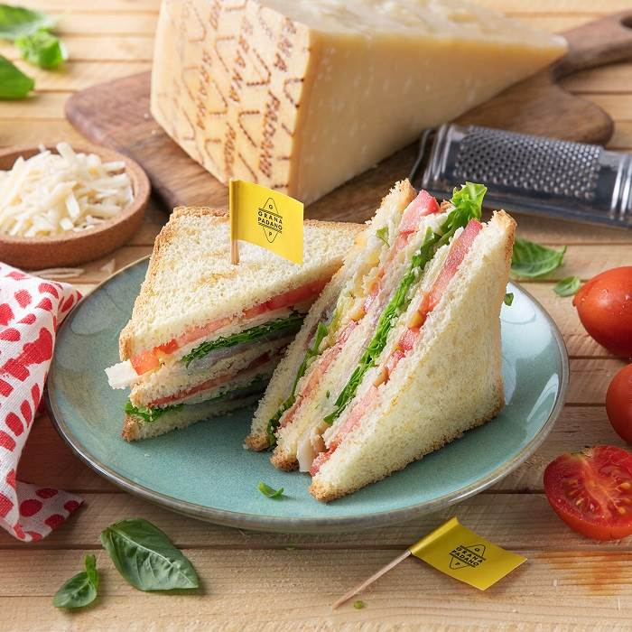 Smoked swordfish Club Sandwich with tomatoes, salad, mayonnaise and Grana Padano