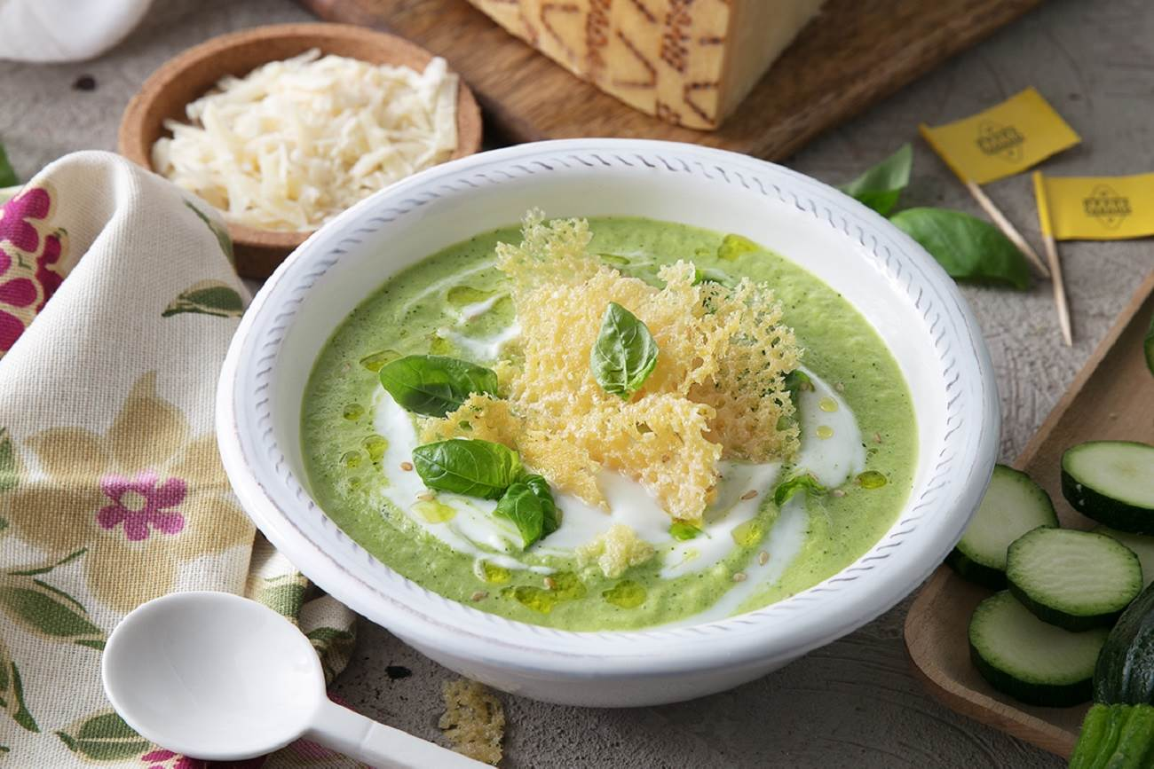 Cold soup of courgettes, yoghurt, sesame, and basil with Grana Padano wafer
