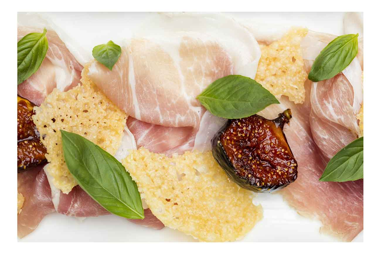 Figs roasted in sherry vinegar caramel, Grana Padano crisps & Prosciutto di San Daniele