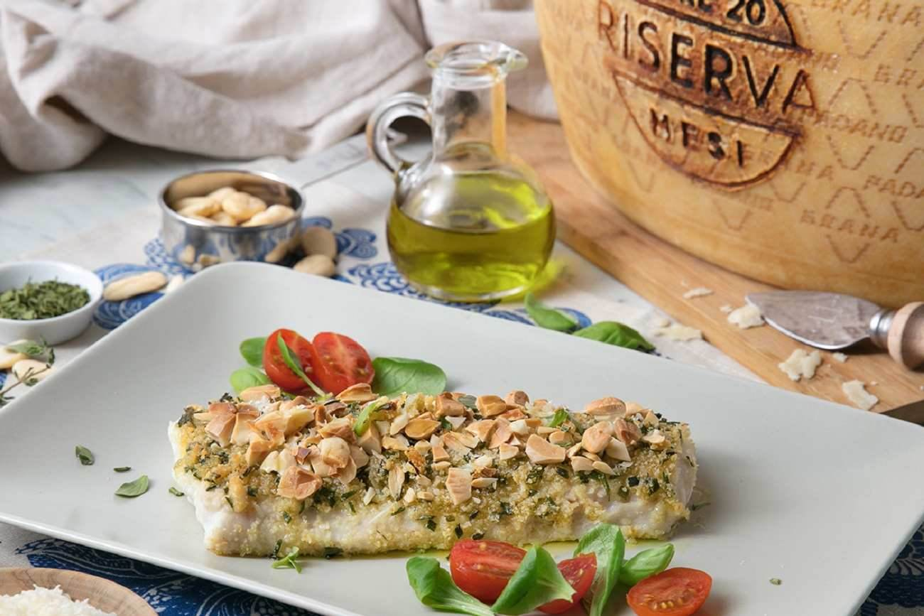 Baked cod fillet in a crust of Grana Padano Riserva, almonds, breadcrumbs and herbs