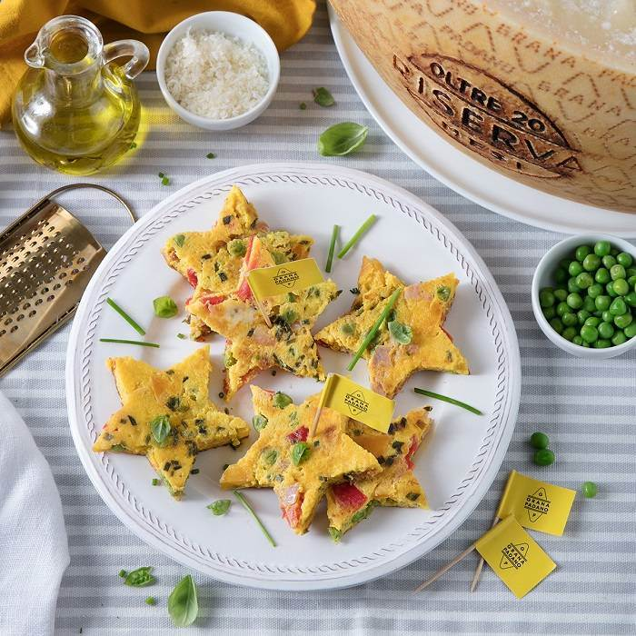 Frittata stars with seasonal vegetables, Grana Padano Riserva and diced ham