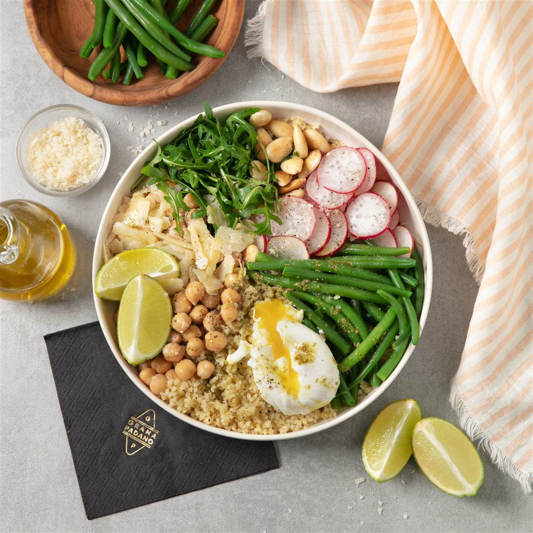 Couscous with poached egg, green beans, roasted almonds, chickpeas and basil, with Grana Padano Riserva