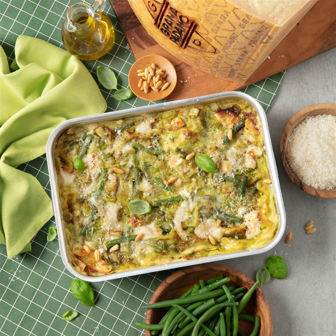 Pesto lasagna with green beans, potatoes and Grana Padano