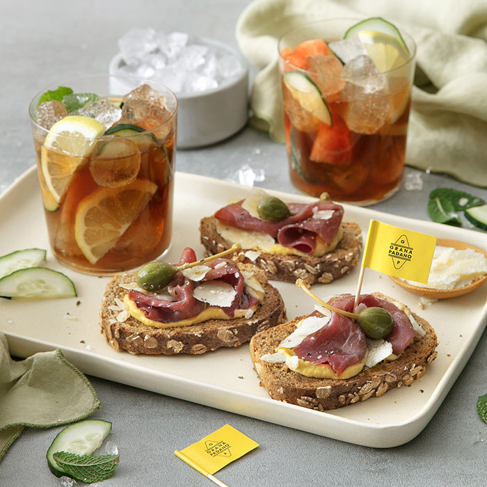 "Classic Pimm's and Crostini with Grana Padano Riserva, ""Carne Salada"", Capers and Mustard"