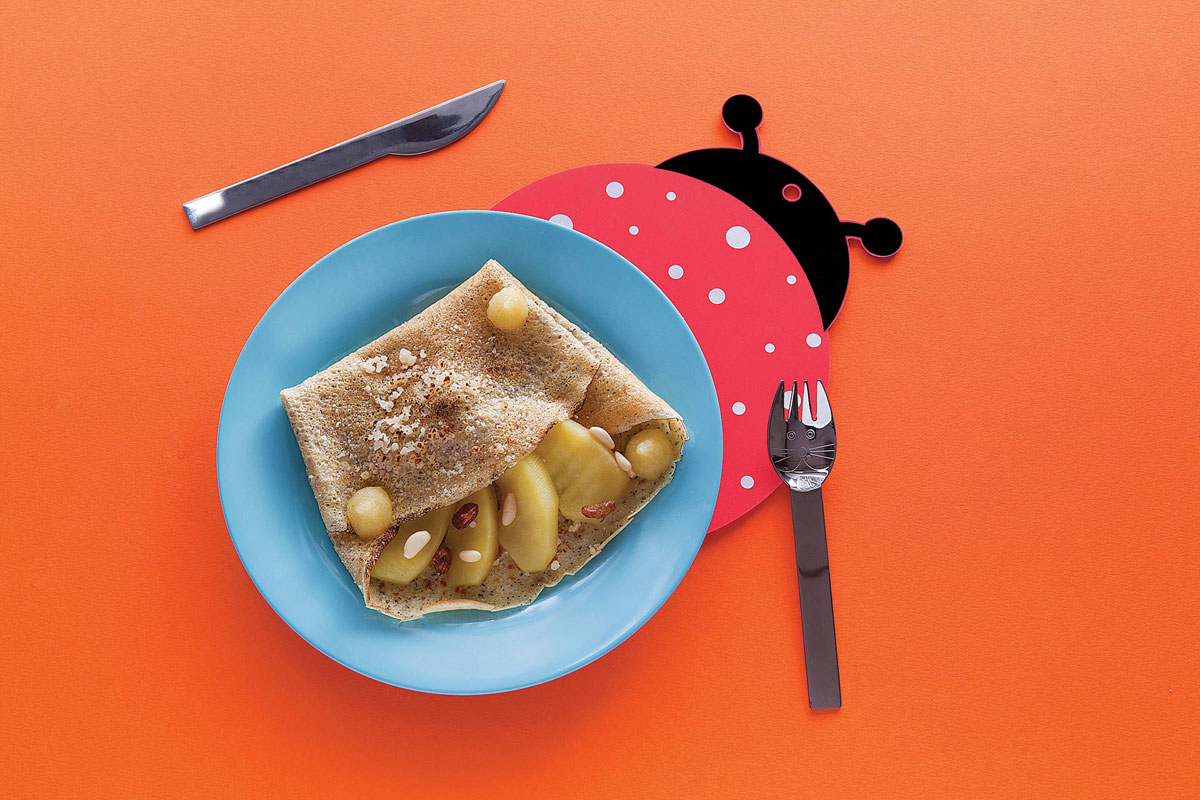 Buckwheat pancakes with Grana Padano, apples, raisins and pine kernels