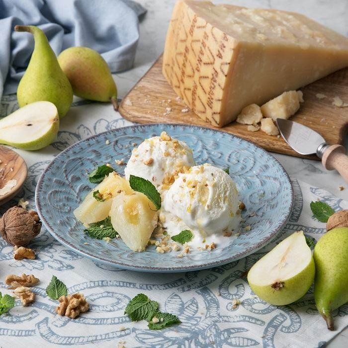 Grana Padano PDO ice cream with pears in syrup, chopped walnuts and fresh mint