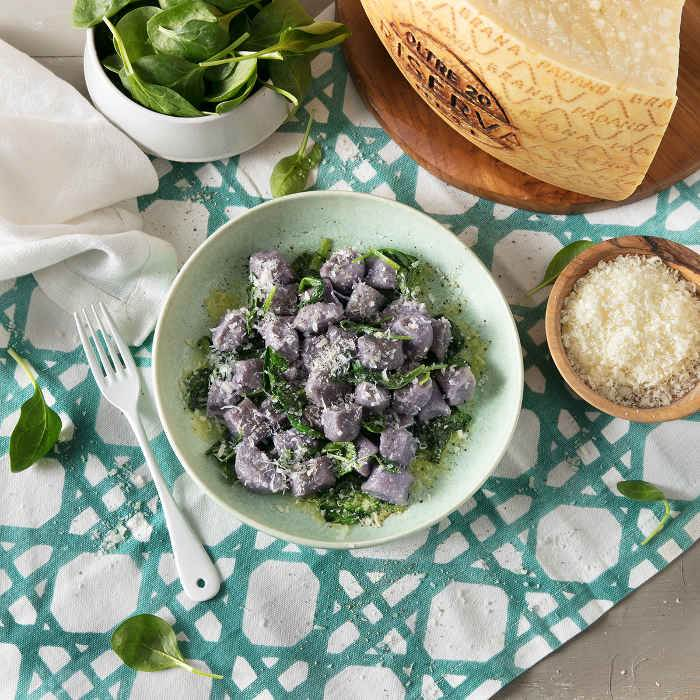 Purple Potato Gnocchi and Baby Spinach with Grana Padano Riserva