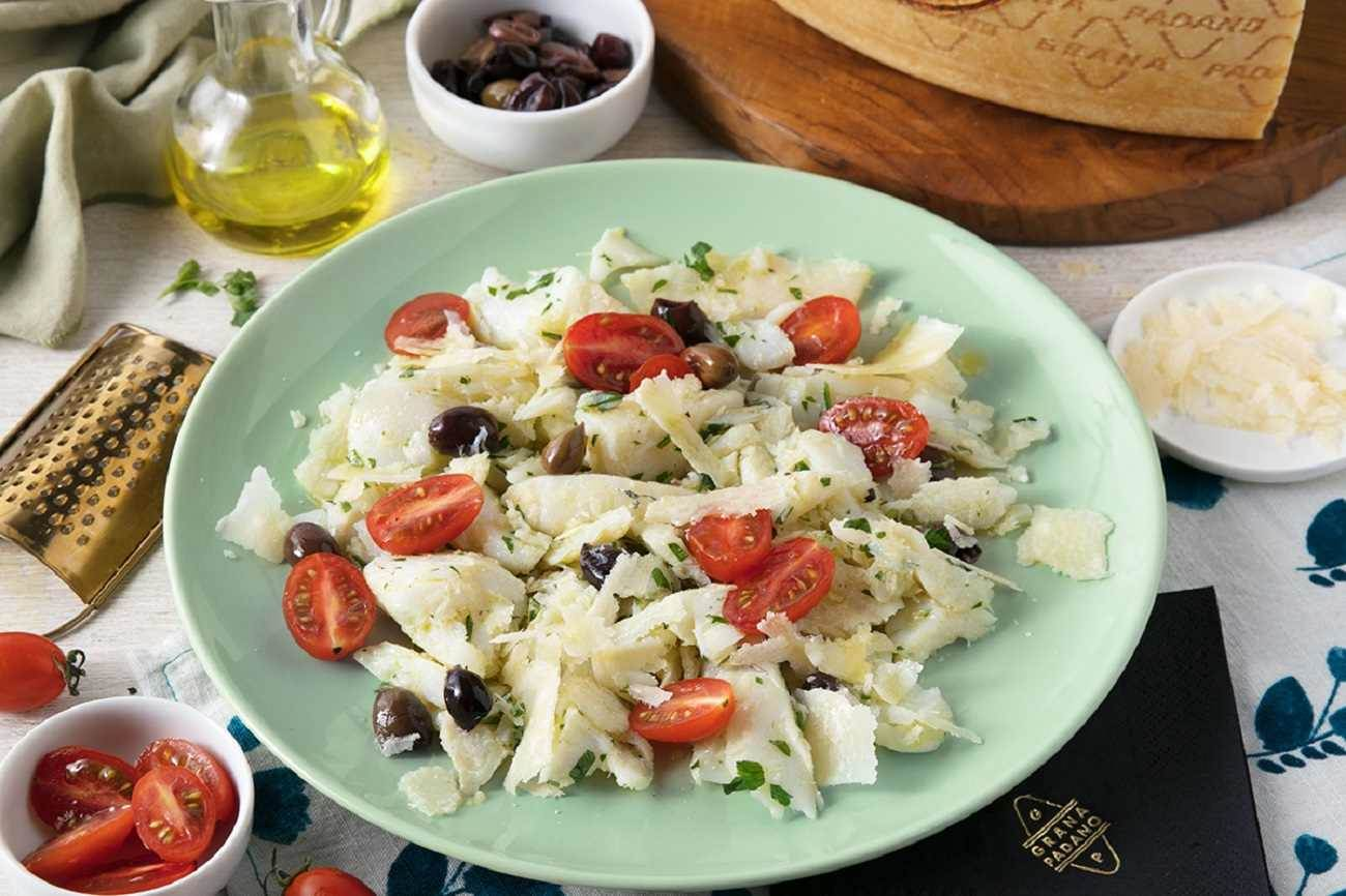 Salted cod salad with cherry tomatoes, Taggiasca olives, parsley and Grana Padano Riserva