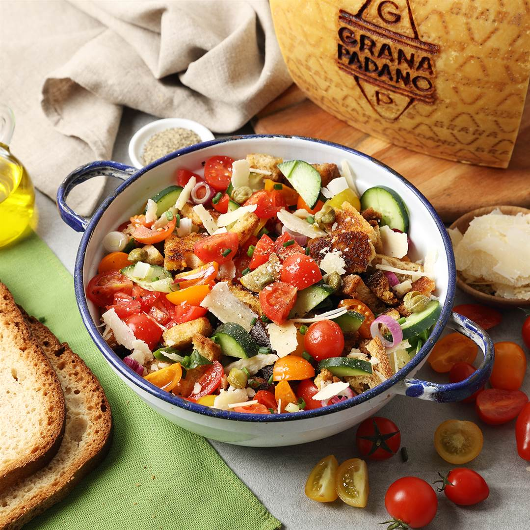 Crunchy bread salad with tomatoes, cucumbers, red onion, capers and Grana Padano