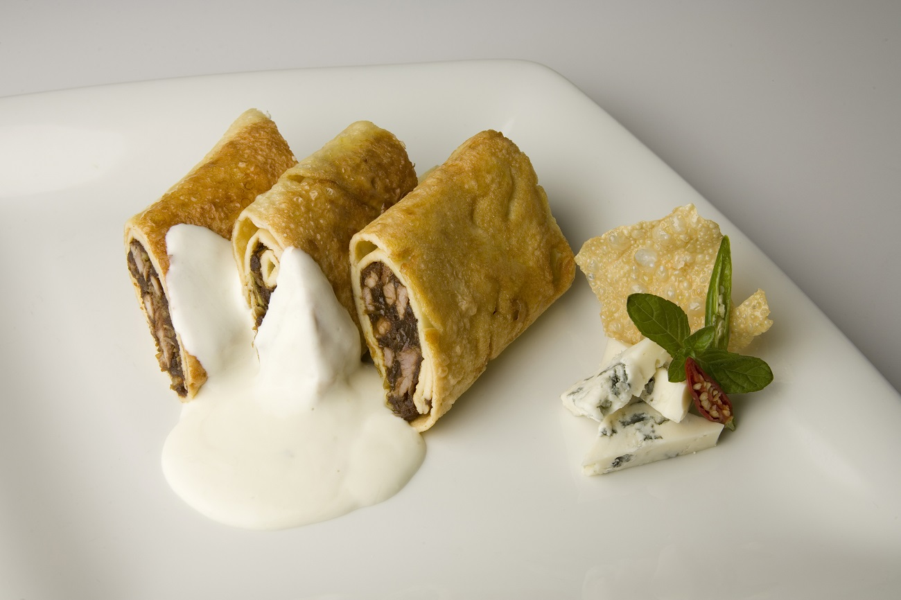 Pan-fried spring-rolls with Gorgonzola cream