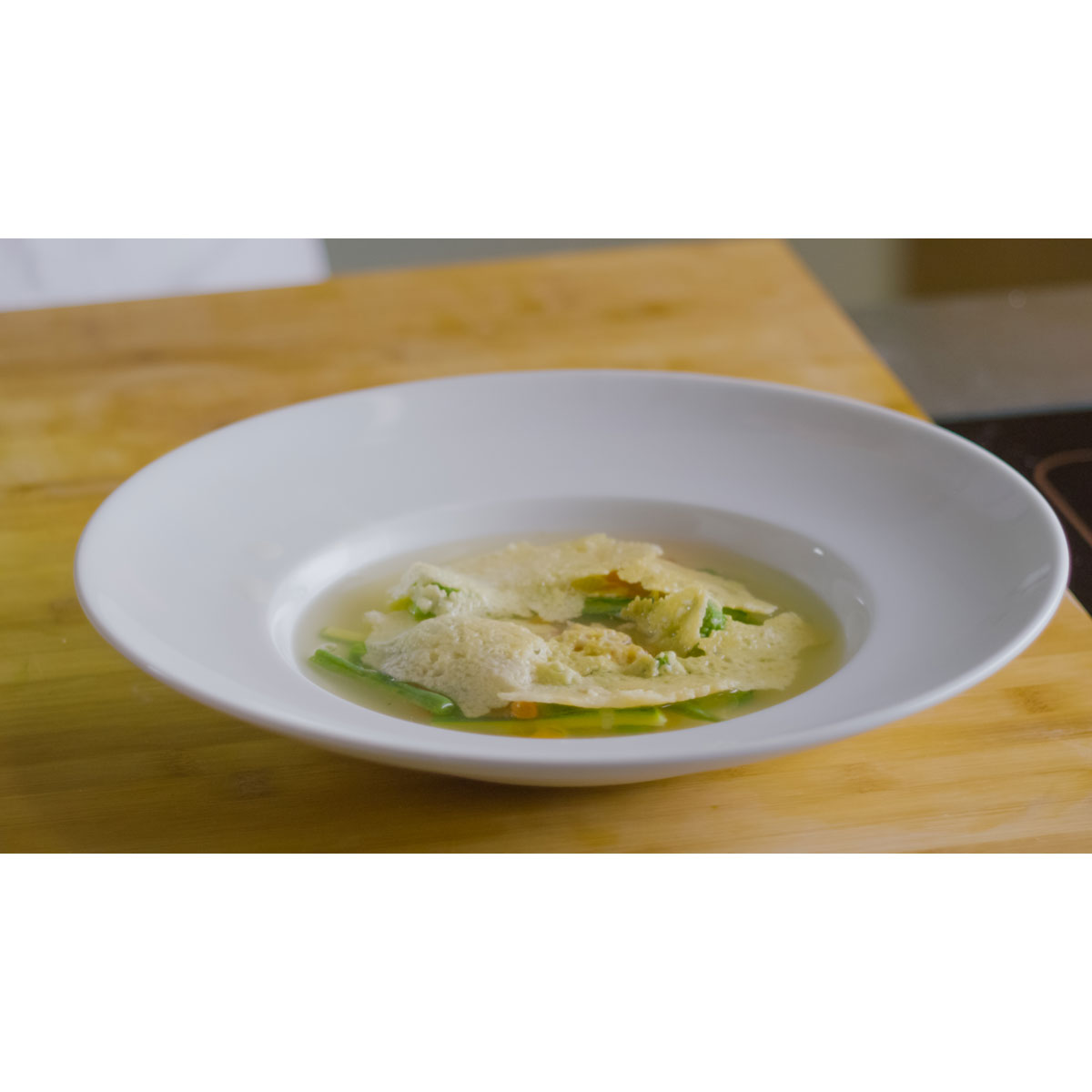 Vegetable minestrone soup with Grana Padano crispy crust