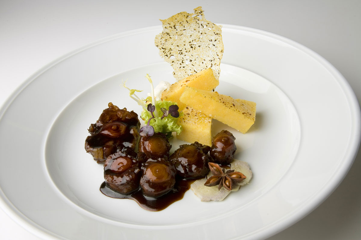 Oxtail simmered in red wine from Valtellina with crispy polenta and Grana Padano