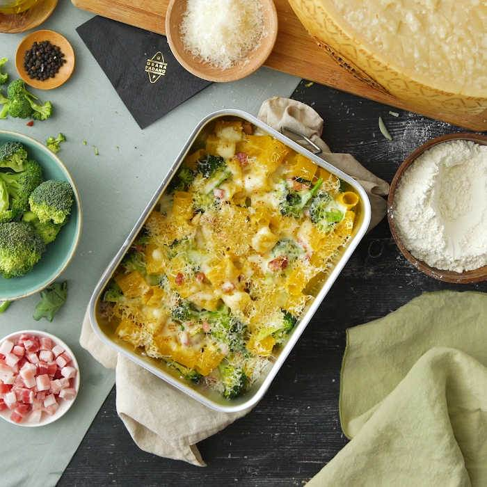 Oven baked pasta with bechamel, broccoli, bacon and Grana Padano Riserva