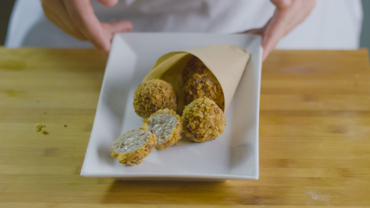 Fried meatballs with a heart of Grana Padano