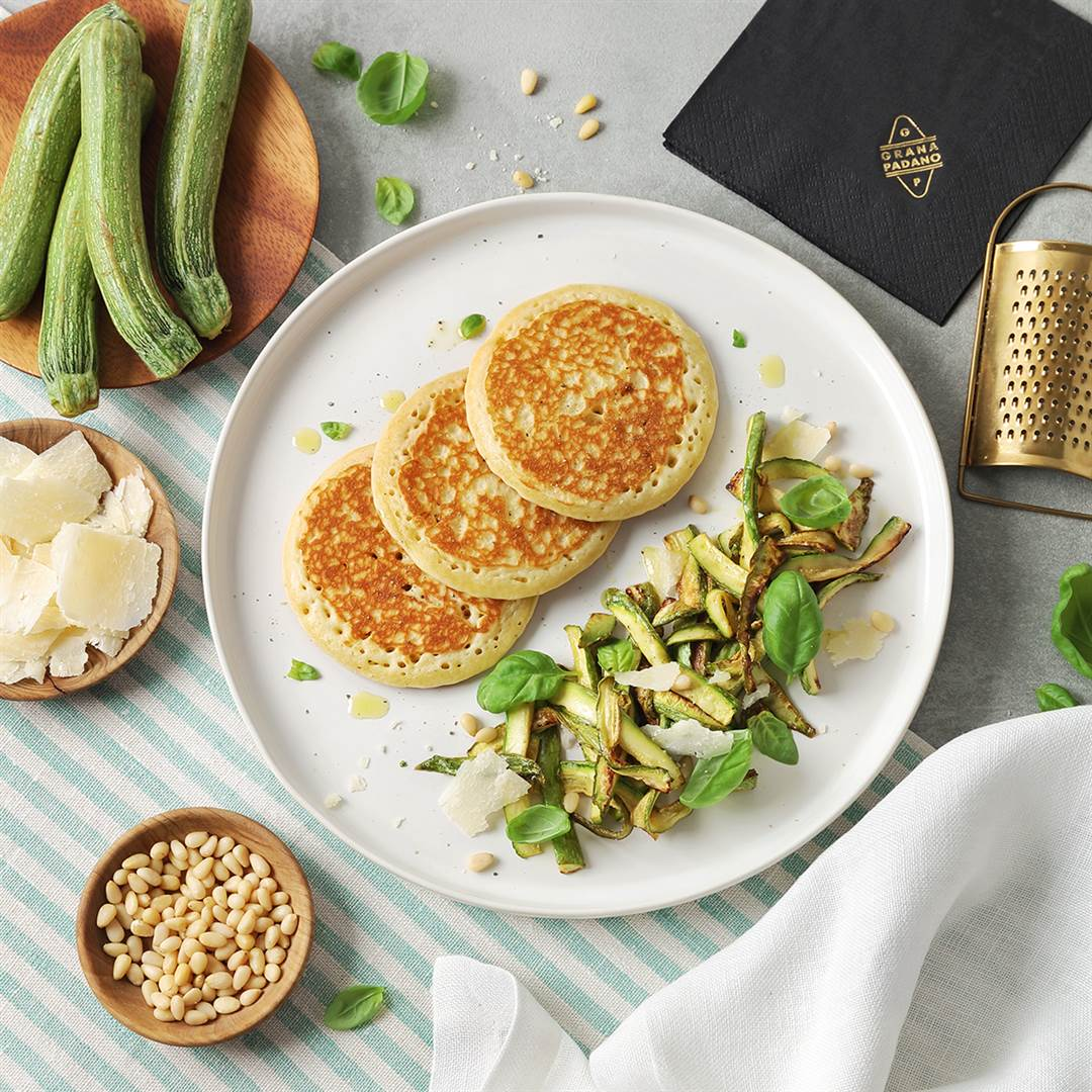 Savoury pancakes with courgettes, pine nuts, basil and Grana Padano Riserva