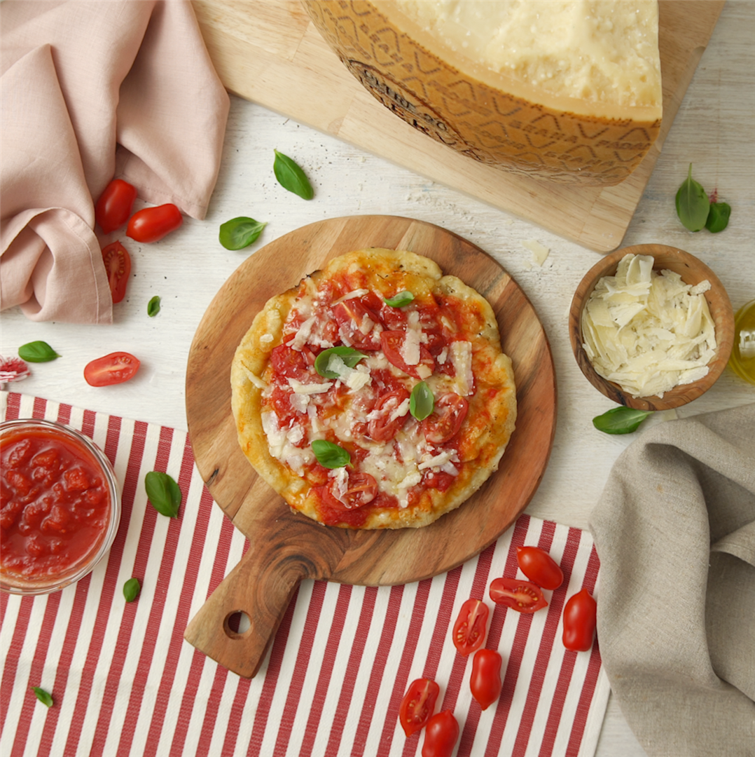 Pan-cooked pizza with tomato, basil and Grana Padana Riserva