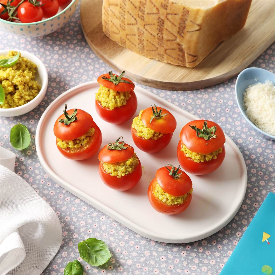 Fresh vine tomatoes stuffed with couscous, basil and Grana Padano