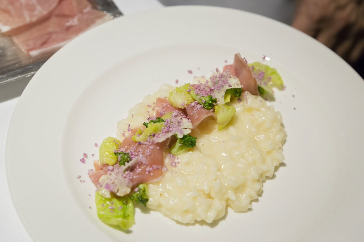 Risotto with olive oil, Grana Padano, cauliflowers and Prosciutto di San Daniele