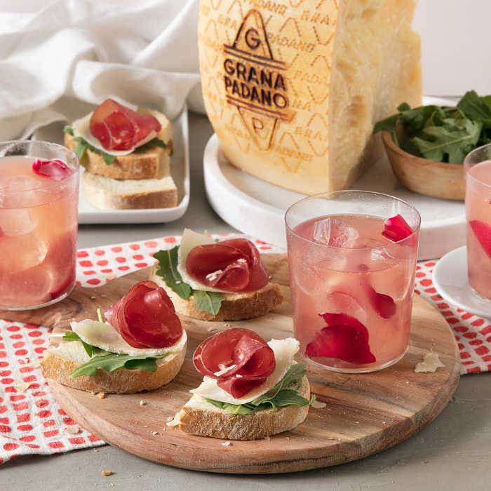 Rose Lemon Spritzer and Bread Canapés with Bresaola, Rocket, Lemon and Shavings of Grana Padano