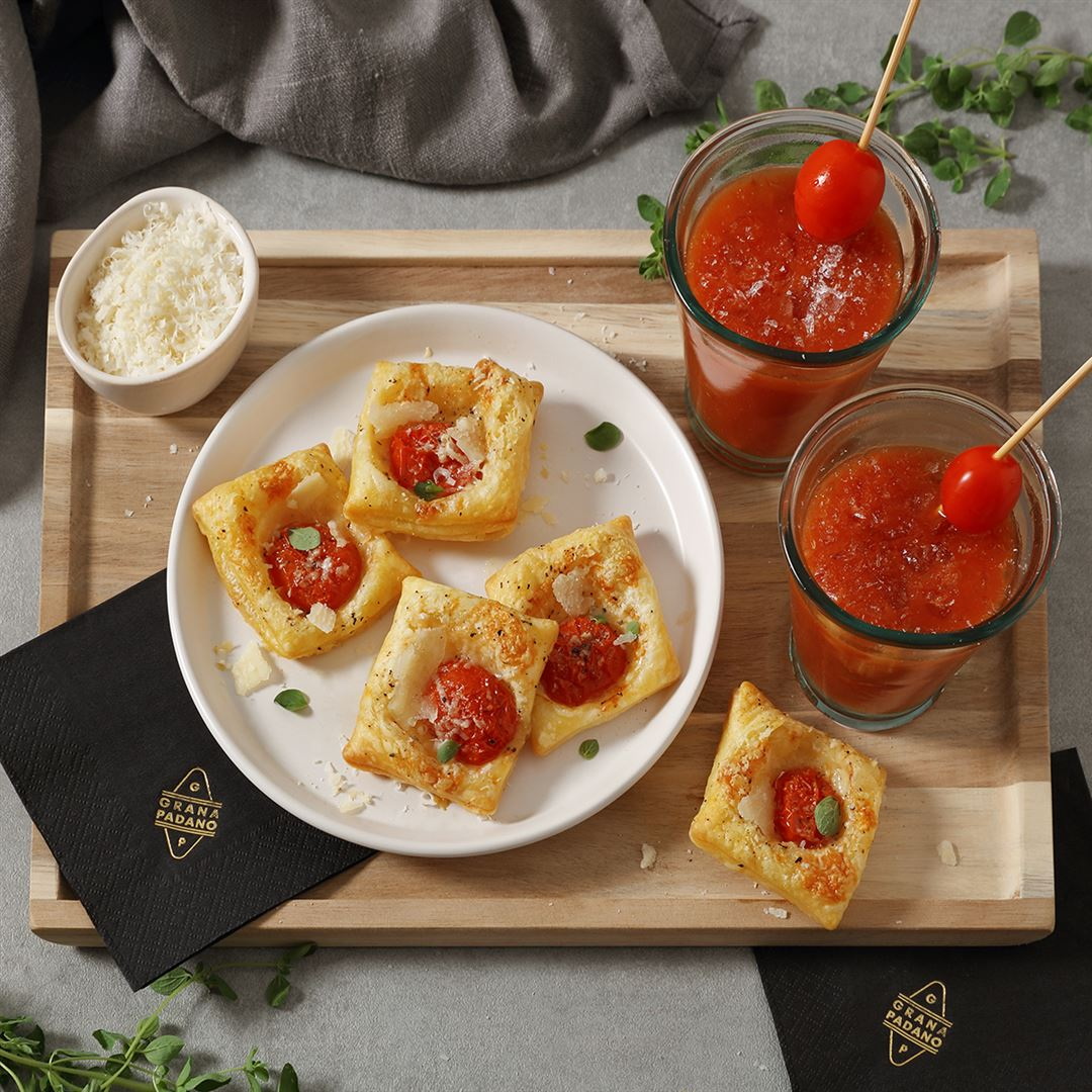 Non-alcoholic Tomato Cocktail served with Puff Pastry Snacks filled with Cherry Tomatoes, Oregano and Grana Padano Riserva