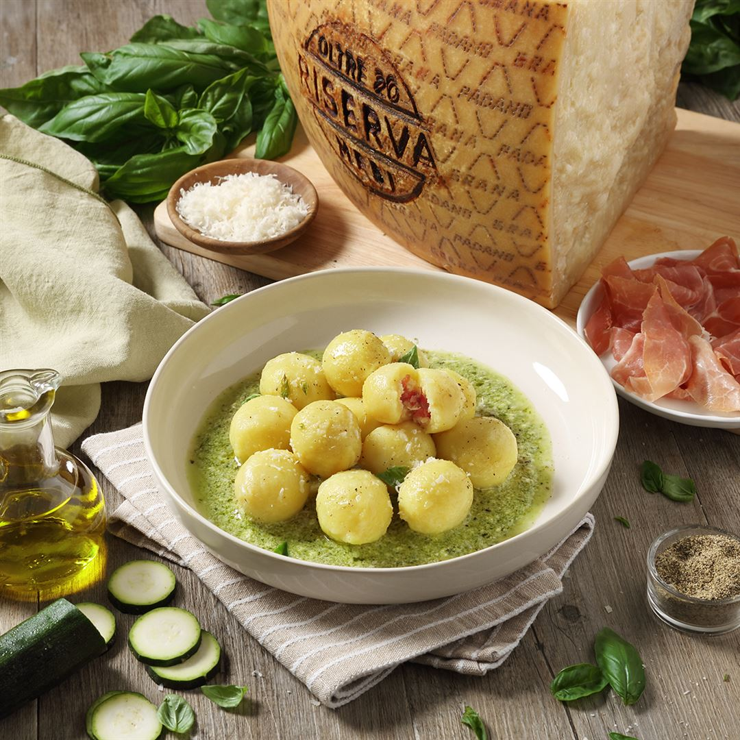Potato Gnocchi Filled with Grana Padano Riserva and Prosciutto, garnished with Courgette and Basil Pesto