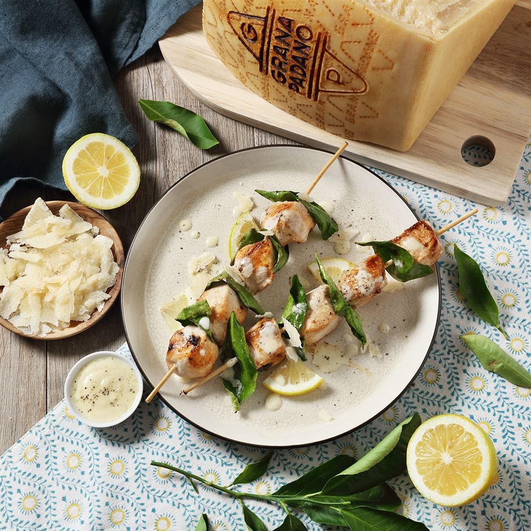 Grilled Chicken Skewers with Lemon Leaves and Creamy Grana Padano Sauce