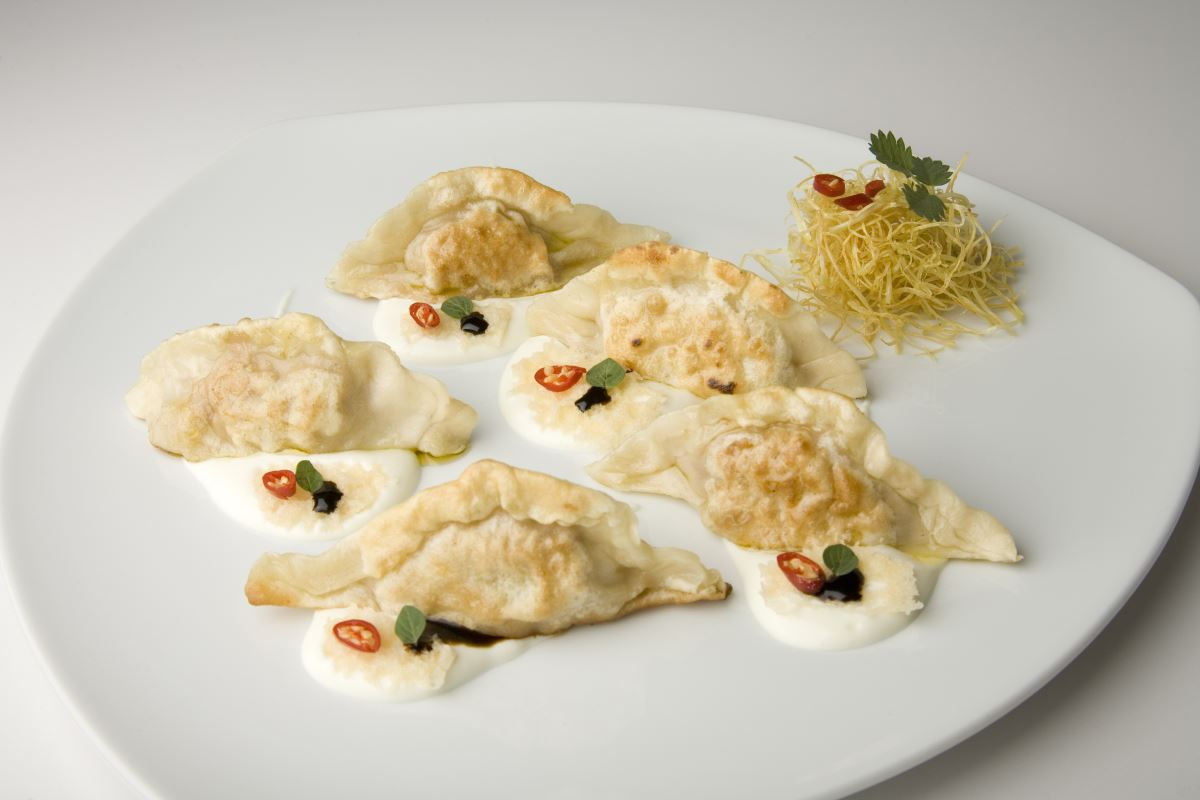 Sautéed dumplings with a Taleggio cheese cream