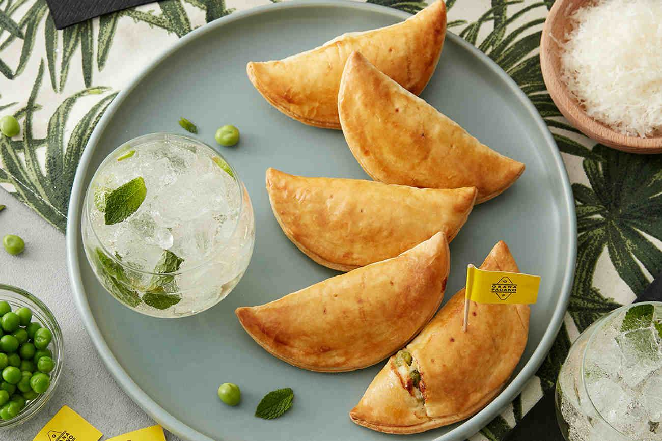 Non-alcoholic Elderflower Syrup White Spritz with Turnovers with Grana Padano