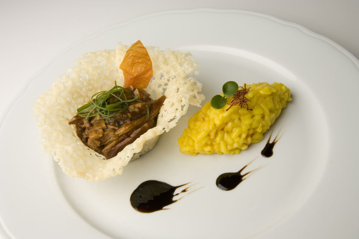 Stewed mutton in Grana Padano baskets with a Carnaroli risotto Milan style