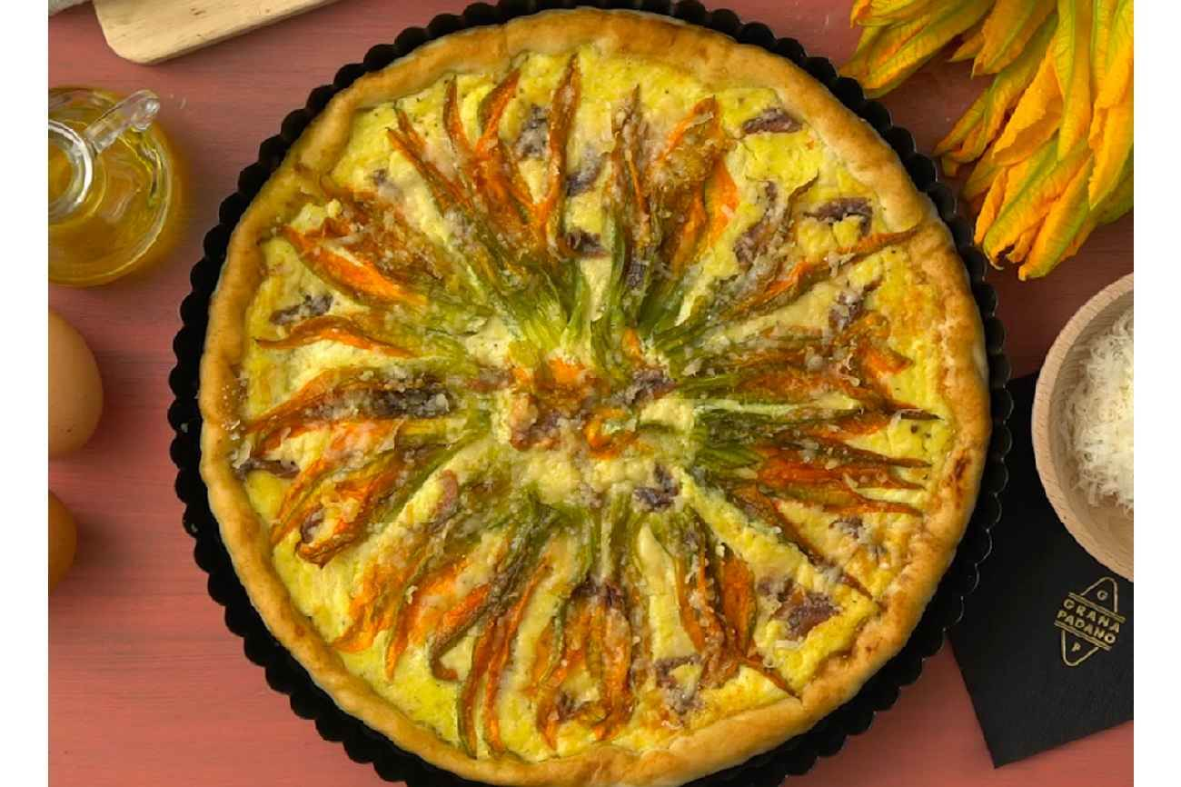 Savoury summer pie with courgette flowers and Grana Padano