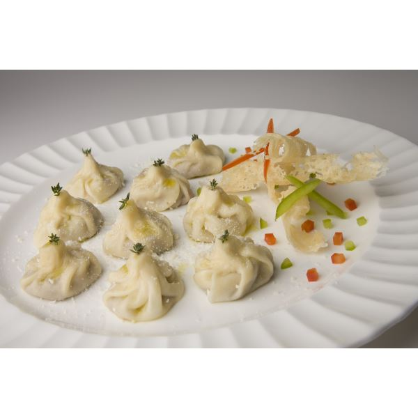 Tasty steamed dumplings with four cheese sauce