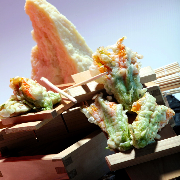 Tempura of zucchini flowers stuffed with Grana Padano