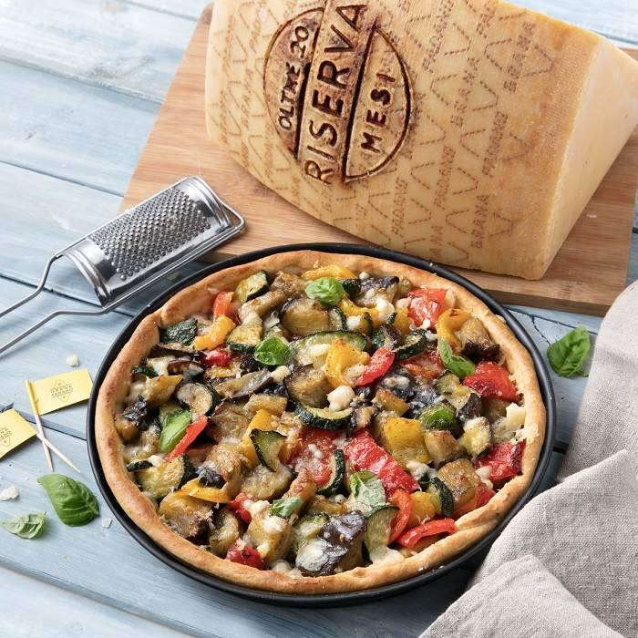 Savoury pie with vegetable ratatouille (aubergines, courgettes, peppers, onions) and Grana Padano Riserva
