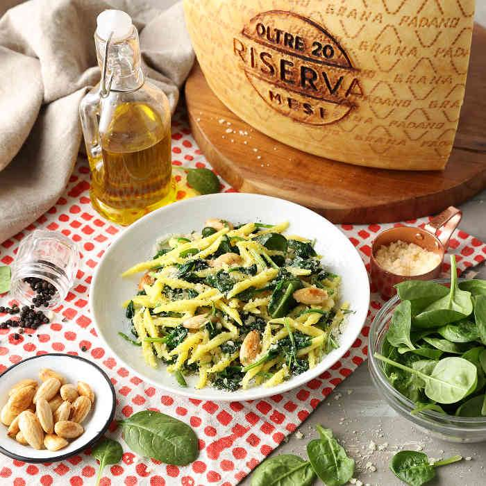 Trofie with sautéed spinach, almonds and Grana Padano Riserva