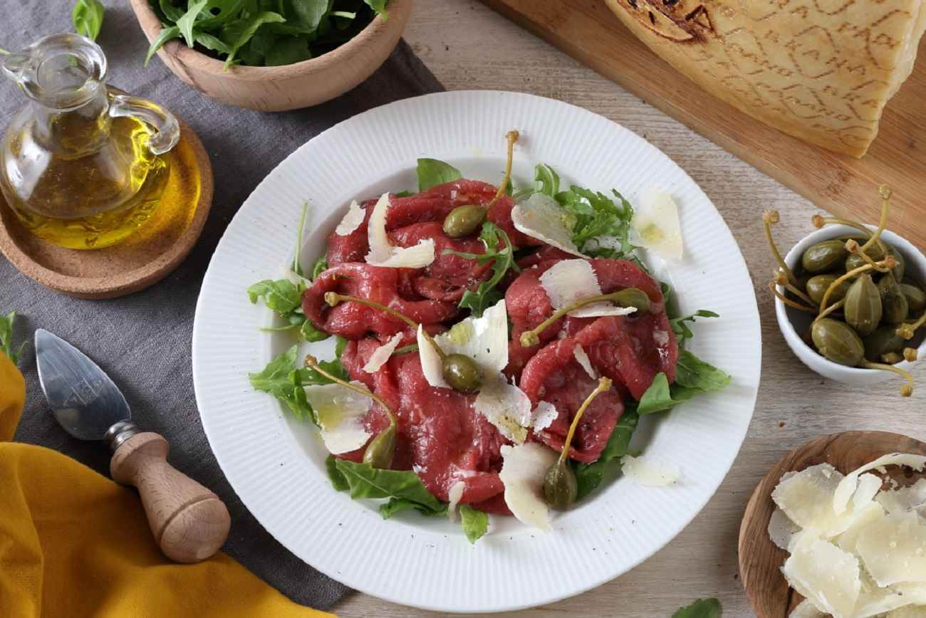 Beef Carpaccio with Capers, Rocket and Shavings of Grana Padano RISERVA