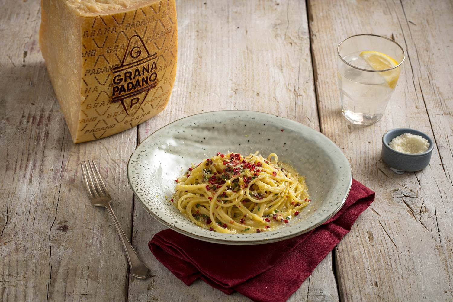 Spaghetti Grana Padano with pink peppercorn and Amalfi lemon