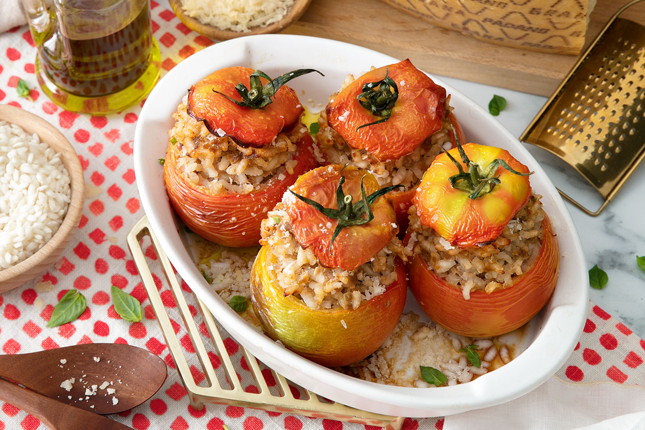 Baked Beefsteak Tomatoes Stuffed with Rice, Minced Meat and Grana Padano Riserva