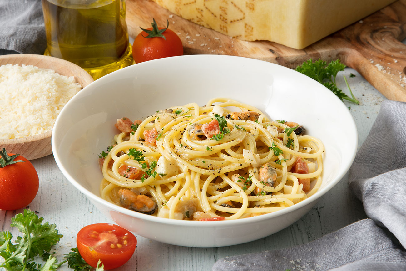 Spaghetti Carbonara with Seafood, Grana Padano and Parsley
