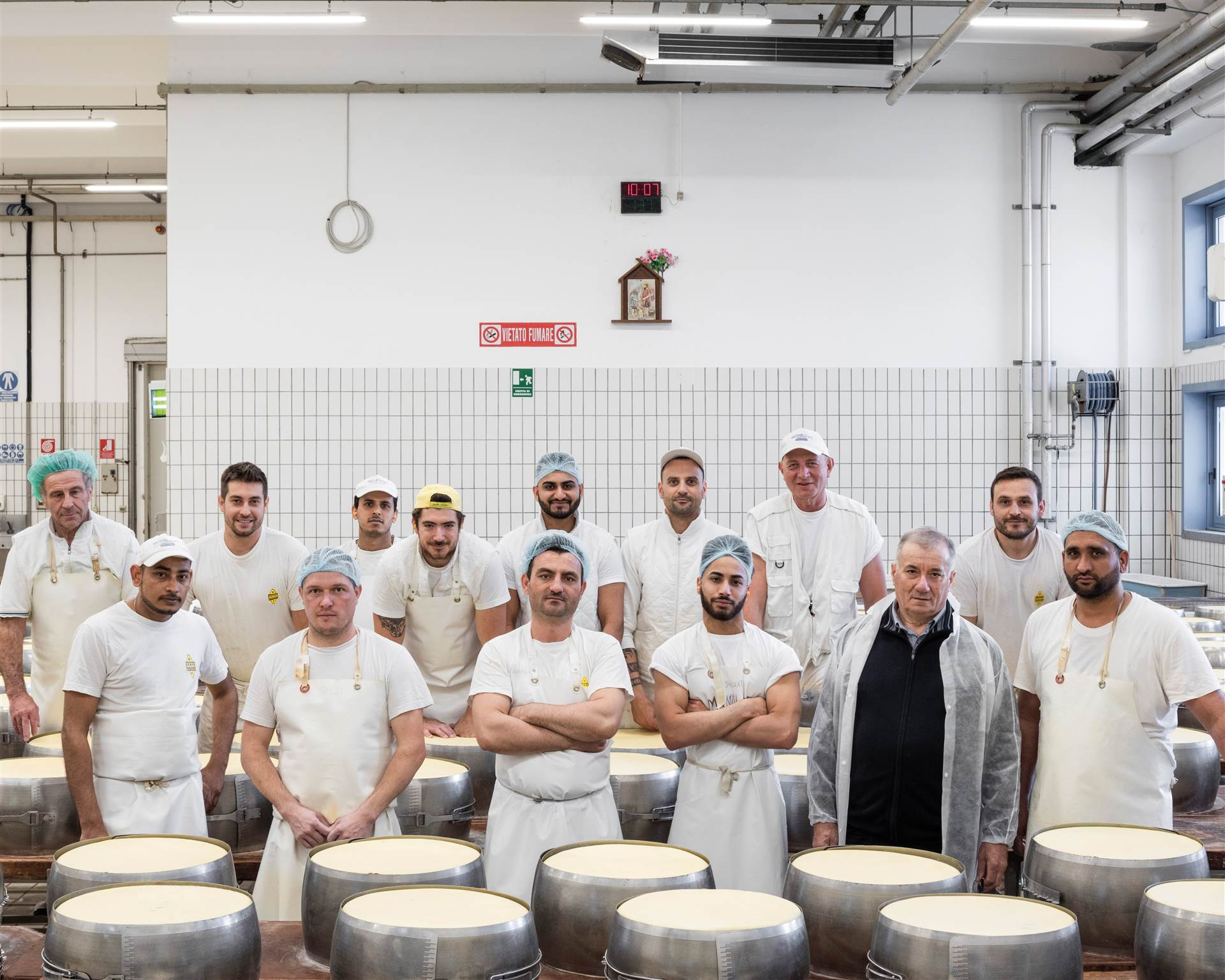 The team of technicians working in the dairy. <br>In the front row, second from the right, the president of the cooperative, Renato Zaghini