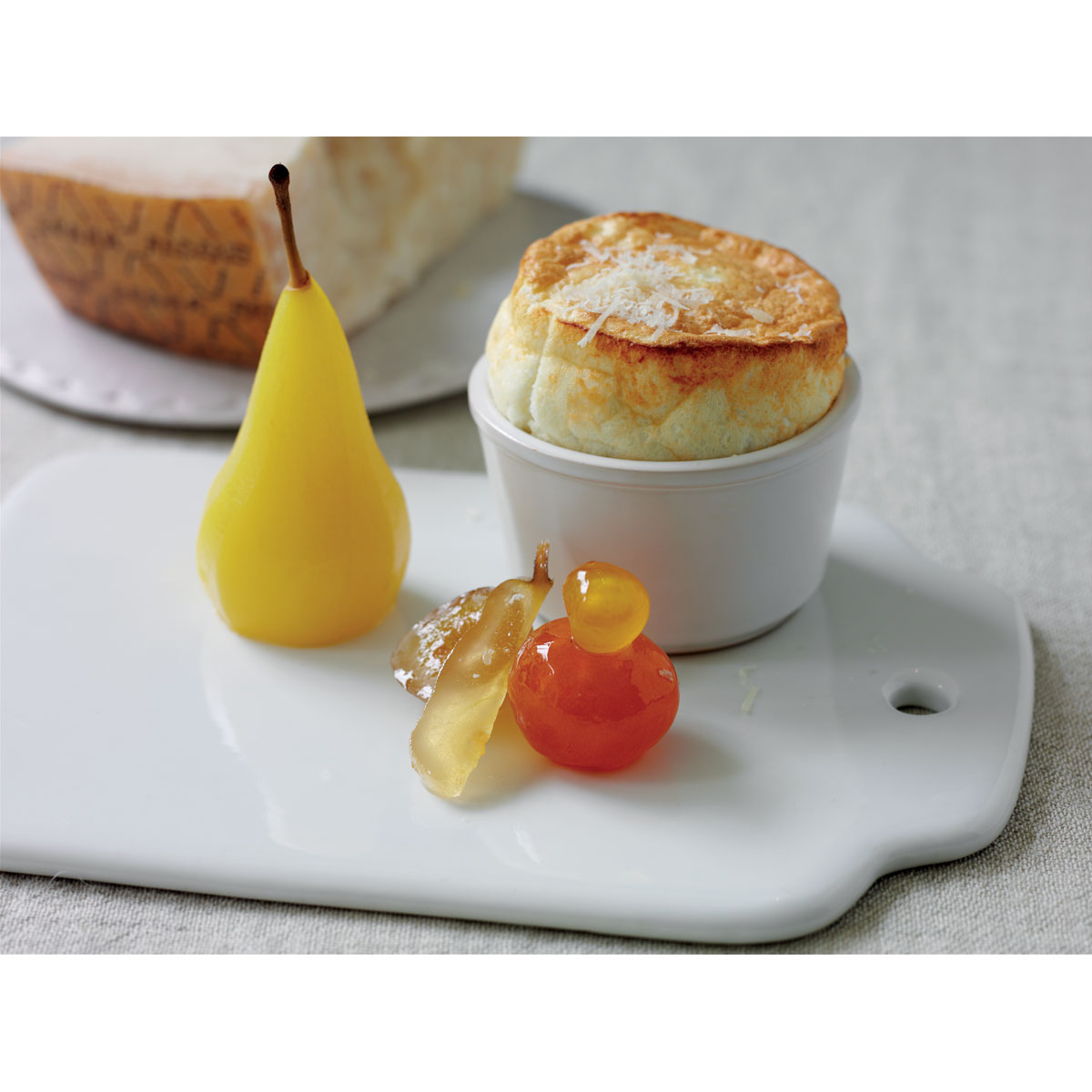 Grana Padano Riserva soufflé with fruit mustard & poached pears