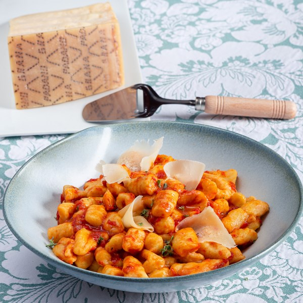 Gnocchi with meat ragù and Grana Padano petals