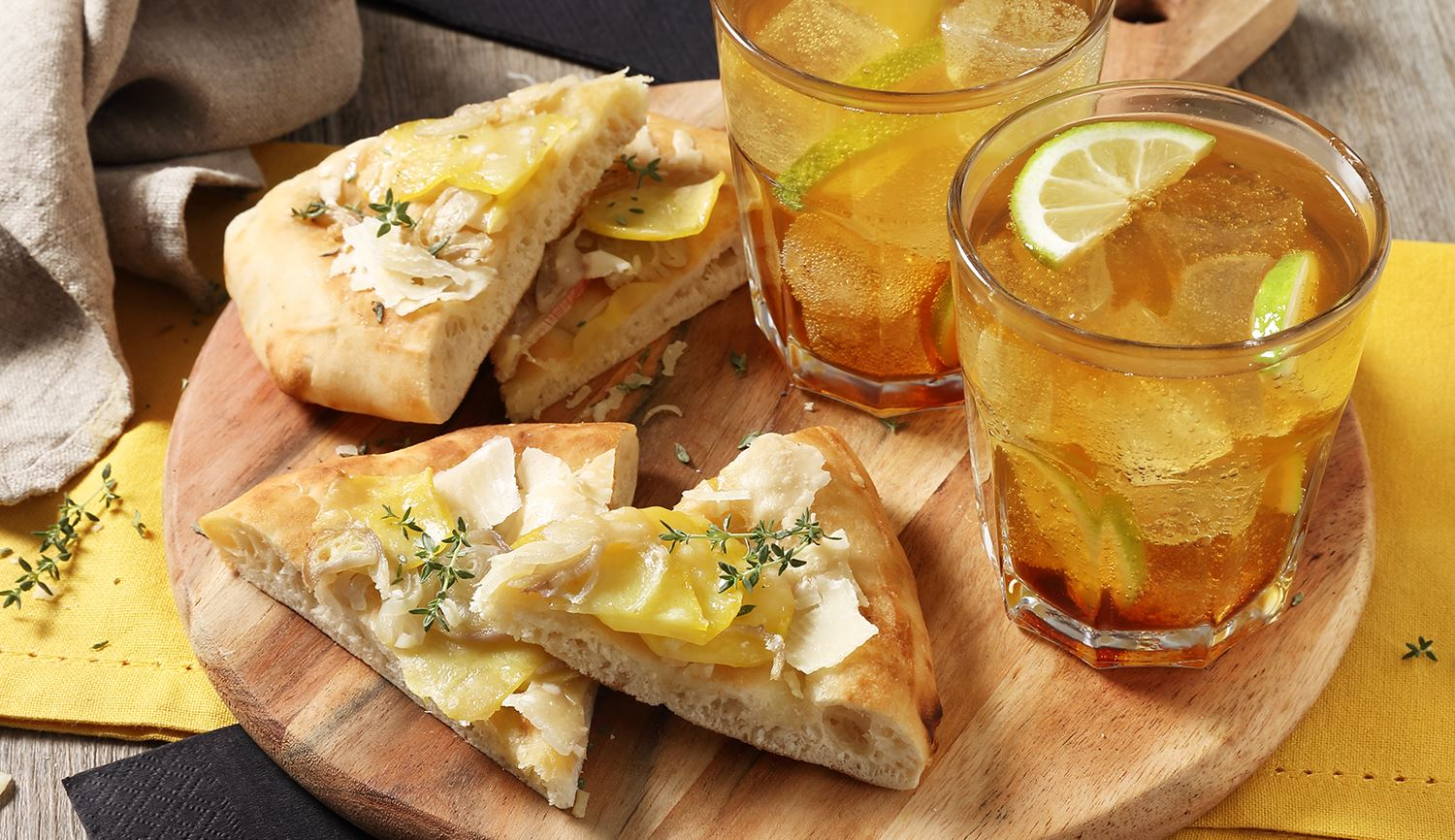 Cynar Spritz served with Focaccia garnished with Potatoes, Onions and Grana Padano Riserva
