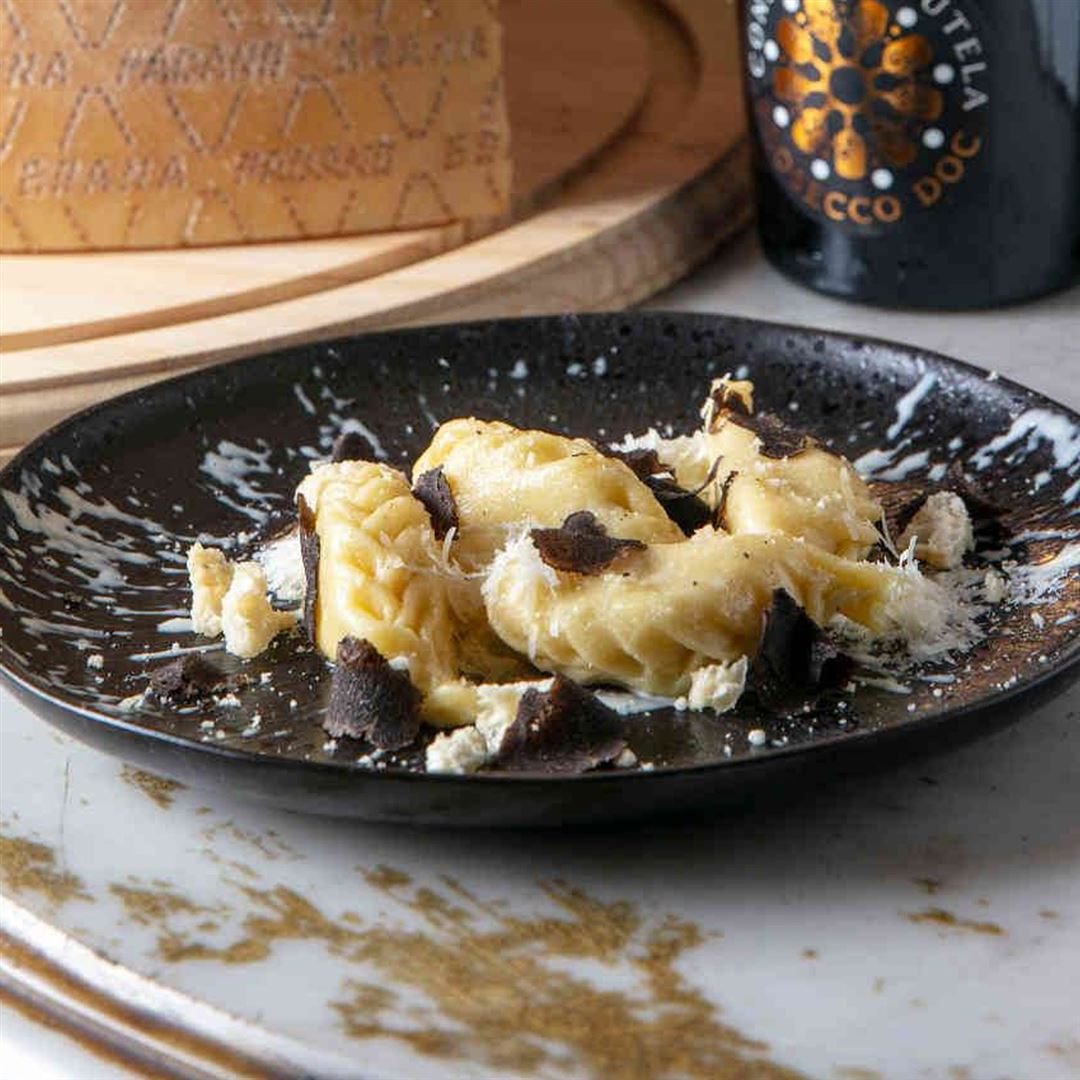Grana Padano and black truffle Culurgiones