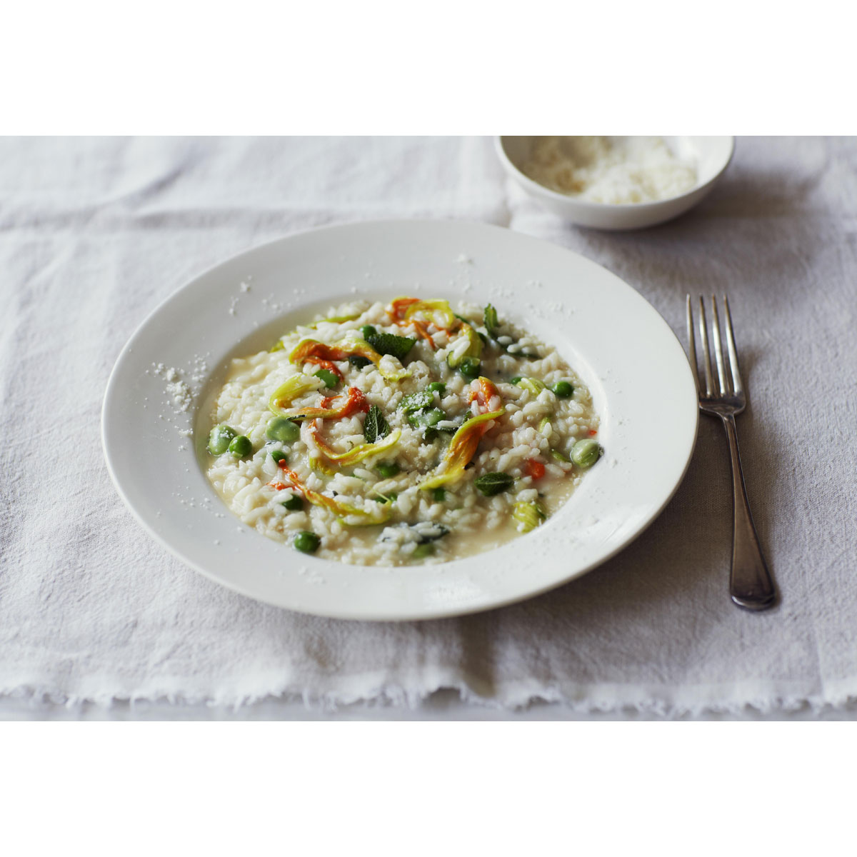 Risotto with broad beans, peas, courgette flowers, Grana Padano and mint