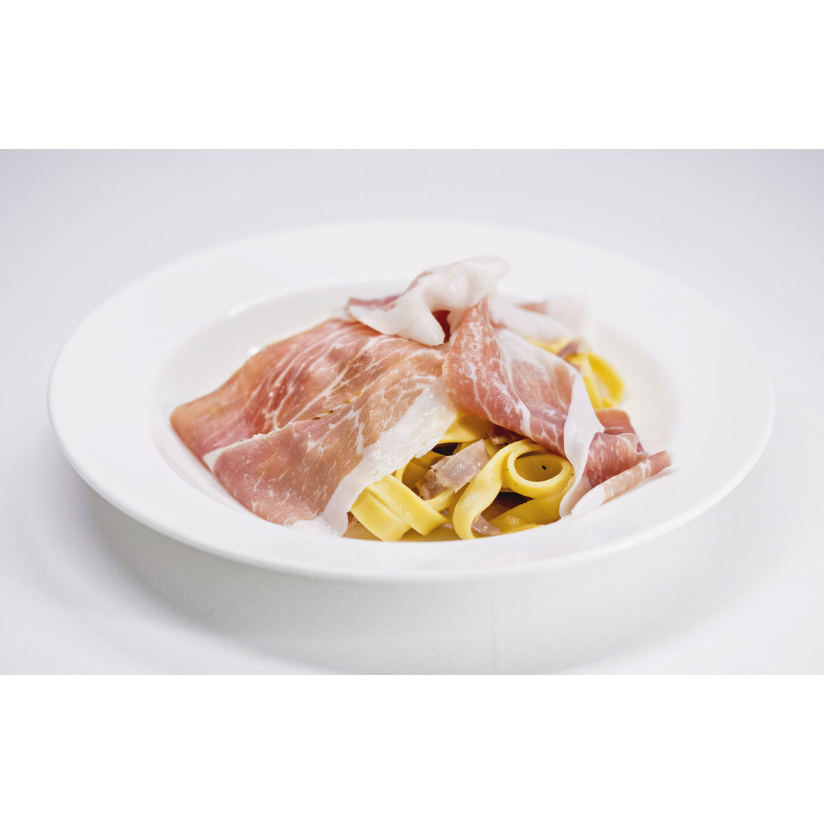 Tagliatelle with Grana Padano cheese and prosciutto di San Daniele
